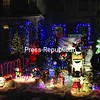 This house on Lorraine Street off Cumberland Avenue in Plattsburgh features penguins on an animated teeter-totter candy cane; an inflatable Santa; an illuminated Christmas mouse, moose and snowmen; a multitude of lights; and a fully decorated tree on the home's porch. See more photos of North Country decorations on Page A3. <br><br>(P-R Photo/Gabe Dickens)