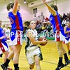 Brittany Marshall of Franklin Academy splits Ausable Valley defenders Alexis Facteau (left) and Alexis Coolidge on her way to the basket in the second quarter Friday night in Malone. Marshall rallied the Huskies to a 59-56 victory.<br><br>(P-R Photo/Pat Hendrick)