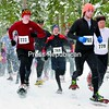 Runners take off in a cloud of snow at the start of the Jingle Bell 5K Snowshoe Race Saturday in Paul Smiths. The annual event attracted 30 snowshoers.<br><br>(P-R Photo/Pat Hendrick)