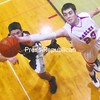 Beekmantown's Foster Ebersole (23) extends his reach to come up with the rebound over Northeastern Clinton's Tom Bedard in a CVAC boys' basketball opener Friday night in Beekmantown. The visiting Cougars nearly let a 22-point halftime lead slip away before holding on for a 52-51 victory. Bonus photos from this game will be available at pressrepublicanphotos.com on Monday.<br><br>(P-R Photo/Andrew Wyatt)