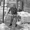 Jeff Farnsworth shovels snow at Aubuchon Hardware in Port Henry. Some areas of the community got more than a foot of snow overnight into Wednesday.<br><br>(Staff Photo/Lohr McKinstry)