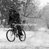 An Albany man bikes in the snow Wednesday.<br><br>(AP)