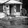 Firefighters assess the situation at a flooded house at 771 Salmon St. in Fort Covington. The house, located on the east side of the Salmon River, is one of a number in the community that is surrounded by floodwaters.<br><br>(Staff Photo/Denise Raymo)