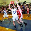Peru's Emily Decker (12) comes down with the rebound and looks to outlet the ball to teammate Alex King (34) in CVAC girls' basketball action Thursday in Peru. Saranac's Katie McCasland applies the pressure. Saranac completed a season sweep of Peru.<br><br>(P-R Photo/Michael Betts)