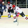 Beekmantown defenseman Frank Buksa looks to move the puck up the ice during Wednesday's nonleague hockey game against Northwood. Buksa scored a goal in the 4-4 tie.<br><br>(Staff Photo/Kelli Catana)