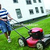 Raymond Fortin of Plattsburgh volunteers cutting grass on the property of the Brothers of Christian Instruction on Court Street in Plattsburgh. Fortin also picks up groceries for a local food bank.<br><br>(P-R Photo/Andrew Wyatt)