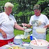 Susan Carr Lawson (right) serves strawberry shortcake to Mary Simmers at a recent reunion of the Camp Red Wing/Red Cloud campers at Point au Roche State Park. The 11th reunion, which occurs every two years, attracts former campers from across the United States. This year, 60 people attended. The camp was a summer favorite for youths from the 1930s until the mid-1960s.<br><br>(P-R Photo/Bruce Rowland)
