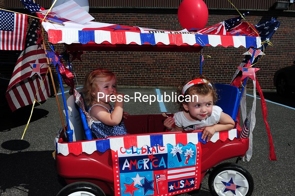 Ally Bourgeois, 2, and Delaney Knapp 15 months, of Saranac Lake took part in the Saranac Lake Kiddie Parade Saturday in this highly decorated wagon. The parade route traveled through downtown Saranac Lake and then to the park, where participants were given ribbons and ice cream.<br /><br />(P-R Photo/Jack LaDuke)