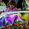 Skyler Smart, 3, of Peru enjoys a toy fishing game during the Clinton County Fair, which was held last week in Morrisonville. Fair officials say good weather helped attendance rise this year.<br><br>(P-R Photo/Andrew Wyatt)