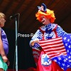 Brianna Messier, 8, of Waitsfield, VT, helps Pipsqueak the Clown return the flag to it's former glory during a magic show at the Rouses Point 50th Annual July 4th celebration Saturday afternoon, but not without a few blunders along the way.<br><br>(P-R Photo/Gabe Dickens)