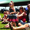 Chazy residents Dan and Angela Bernard and their daughter Abrielle, 2, enjoy Pipsqueak's antics during her show, which featured a lot of crowd interaction. Sunday's events include a car and motorcycle show from 8am to 2pm, a chicken barbecue at noon, parade at 6pm and fireworks over Lake Champlain at dusk. <br><br>(P-R Photo/Gabe Dickens)