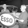 John Weikart (left), who worked for the Esso company in New Jersey for 40 years, donates an original Esso oval sign used on a service station to Dick Soper, exhibit manager/docent at the Champlain Valley Transportation Museum in Plattsburgh. It will be displayed with other automotive history-related memorabilia at the museum. The Esso signs, familiar landmarks years ago, became obsolete when Exxon formally replaced the Esso, Enco and Humble brands in the United States Jan. 1, 1973.<br><br>(P-R Photo/Bruce Rowland)
