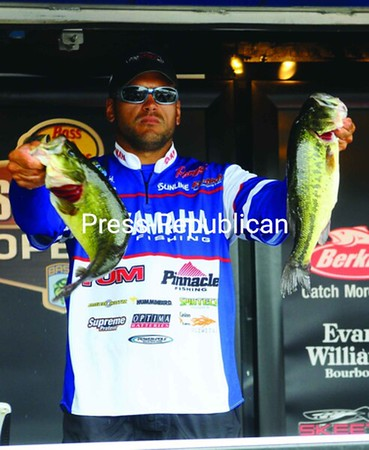 Dave Wolak of Wake Forest, N.C. holds up some of Friday's catch that enabled to take over the leader in the Bass Pro Shops Bassmaster Northern Open on Lake Champlain. The tournament wraps up today with the final weigh-in at 2 p.m. at the Plattsburgh Boat Basin.<br><br>(Staff Photo/Kelli Catana)