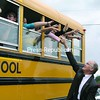 Vermont Gov. James Douglas reaches to waving hands and high-fives from students riding their school bus from Duclos Barstow Memorial School in Chittenden, Vt., to Crown Point Historic Site. The children managed to end up on the same crossing with Douglas and New York Gov. David A. Paterson, heading to the groundbreaking for the new Crown Point bridge.<br><br>(Staff Photo/Kim Smith Dedam)