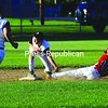 Kyle Erickson (10) of City Fire is tagged out by Play It Again Sports second baseman Nick Dodd in City Babe Ruth League action Monday night at Lefty Wilson Field. City Fire won 5-1. Bonus photos of this game will be on pressrepublicanphotos.com by midday.<br><br>(Staff Photo/Kelli Catana)