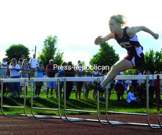 Northeastern Clinton's Mallory Honan leaps over the final hurdle in the 100-meter hurdles Friday.<br><br>(Staff Photo/Kelli Catana)