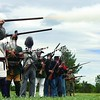 Re-enactors demonstrate firearms used in wars throughout U.S. history Sunday at the fourth-annual Plattsburgh Military Timeline, hosted by the Battle of Plattsburgh Association, at Clyde A. Lewis Park in Plattsburgh. <br><br>(P-R Photo/Clayton Smalley)