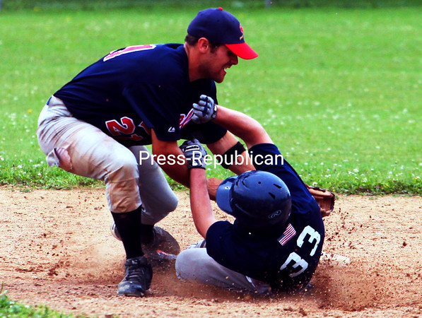 Plattsburgh Cardinals infielder Tom Jebb puts the tag on Lyon Mountain Miners runner Joel Siskavich, who tried unsuccessfully to steal second base during the ninth inning of Sunday's first game of a CVBL doubleheader at Lefty Wilson Field. The Miners recorded a 9-8 win in 10 innings before the Cardinals were an 11-6 winner in Game 2.<br><br>(P-R Photo/Gabe Dickens)