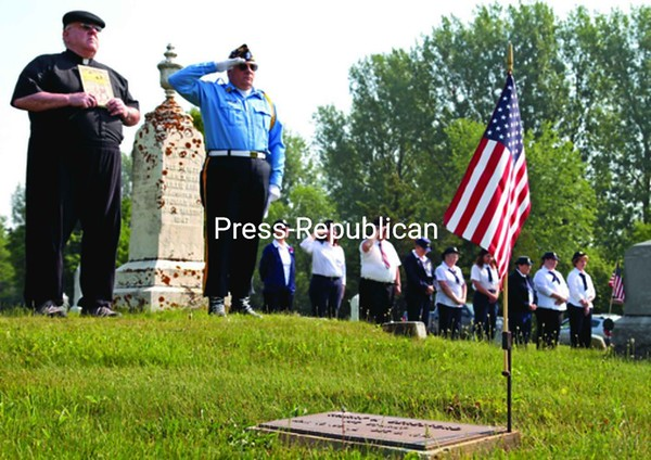 The Rev. Clyde Lewis Jr. of St. Patrick's Church (left) and Commander Robert St. John of American Legion Montgomery Post 912 salute the nation's fallen military during a ceremony at Maple Hill Cemetery, just outside the Village of Rouses Point. Legion and American Legion Auxiliary members, along with the color and honor guards, also on Monday morning visited St. Patrick's Cemetery in Rouses Point, St. Joseph's in Coopersville, and then participated in a wreath-laying ceremony at Dodge Memorial Library in Rouses Point. The post celebrated its 90th birthday last month, and Legion members have been hosting Memorial Day observances since its inception.<br><br>(P-R Photo/Gabe Dickens)
