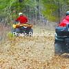 Dan Drowne (right) kicks up leaves as he rides his all-terrain vehicle along a trail with Tom Rafferty.<br><br>(P-R Photo/Rachel Moore)