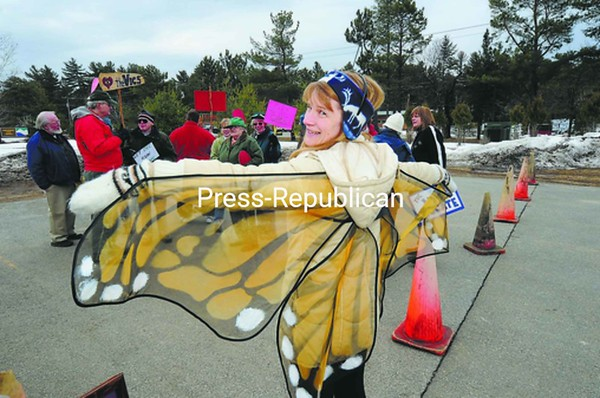 Sue Grimm of Saranac Lake wears butterfly wings at the rally Thursday at Adirondack Park Agency offices in Ray Brook. She is a volunteer at the Visitors Center in Paul Smiths, which has a Butterfly House. The state wants to close down the Visitors Centers because of budget cuts.<br><br>(P-R Photo/Jack LaDuke)