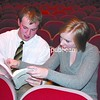 "Chateaugay Central School junior Alex Lamica, who plays the overbearing Captain Von Trapp, and senior Catherine Decosse, who plays the governess Maria, look over the script and discuss a scene from the school's upcoming production of ""The Sound of Music."" The musical is presented March 19 through 21.<br><br>(P-R Photo/Steve Howell)"