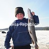 Logan Brown, 8, of the Town of Franklin, struggles to hold up the 6-pound 12-ounce pike he caught Sunday. Brown placed first in the youth category of the Colby Classic Ice Fishing Derby held over the weekend in Saranac Lake. This was the 26th year of the fishing event.<br><br>(P-R Photo/Jack LaDuke)