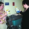 ECH custodial staff worker Barb Mitchell (left) and Public Relations Director Jane Hooper look over some of the environmentally friendly cleaning products utilized at the facility.<br><br>(Staff Photo/Alvin Reiner)