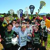 With the Olympic ski jumps looming behind them, members of the Tri-Lakes Lacrosse Team get ready to take part in the Tri-Lakes Youth Lacrosse Jamboree Sunday at the North Elba Show Grounds in Lake Placid. The Jamboree, the culmination of a seven-week program, drew 1,200 youngsters from kindergarten to eighth grade.<br><br>(P-R Photo/Jack LaDuke)