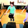 Elizabethtown-Lewis Central School seventh-graders (from left) Leigh Mitchell, Kayle Hagey and Chantel St. Denis make leaps from a standing position on to a series of platforms. It's part of a new physical-education program that emphasizes individual effort.<br><br>(Staff Photo/Alvin Reiner)
