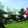 Laurie and Cooper Whitman, who live in the LTS Mobile Home Park in Plattsburgh, survey the damage to their home, which was smashed by a storm-toppled tree Wednesday night. The large tree crushed the center of the structure and cracked the building's frame. See story Page A5. <br><br>(P-R Photo/Andrew Wyatt)