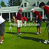 Golfers practice their putting while awaiting their tee times Thursday for the first day of play in the Section VII Golf Championship at the Westport Country Club.<br><br>(Staff Photo/Alvin Reiner)