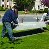 Arnold Pre-cast Inc. of Malone places the concrete foundation to hold a monument commissioned to recognize the sacrifice of American soldiers deployed to the Middle East. The tribute, purchased from funds leftover from the Have-A-Heart Adopt-a-Soldier Program, will be unveiled in Veterans Memorial Park in the Village of Malone on Memorial Day.<br><br>(Staff Photo/Denise A. Raymo)