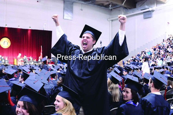 Eric Nabozny of Valatie shows his elation for graduating during the commencement ceremony at Plattsburgh State Saturday morning. Nearly 900 students received diplomas.<br><br>(P-R Photo/Andrew Wyatt)