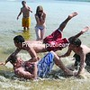 A group of local teens hit the Plattsburgh City Beach and each other in a friendly game of water football Wednesday afternoon. Though the beach doesn't officially open until June 23, local residents have been flocking there to seek refuge from the heat. <br><br>(P-R Photo/Andrew Wyatt)