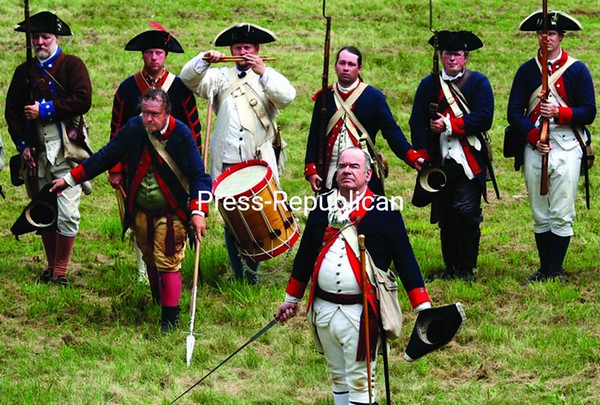 Here, after a French and British skirmish depicting the French and Indian War at Crown Point in '09, re-enactors explain what has transpired.<br><br>(Staff Photo/Alvin Reiner)