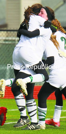 Chazy's Chelsea Guay jumps into the arms of Alexis Bushey after Bushey scored the first goal Friday.<br><br>(P-R Photo/Michael Okoniewski)