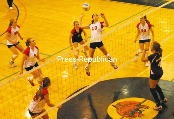 AuSable Valley's Karissa Fuller (10) goes up for the kill in the Class C championship match with Northeastern Clinton. Also shown are Belle O'Toole (5), Kayla Taylor (20), libero Jacquie Hoey and Miranda Sheffer (23). Northeastern Clinton's Jackie Barcomb is also in the picture. AuSable Valley won 3-0. Bonus photos will be available Monday at pressrepublicanphotos.com<br><br>(P-R Photo/Andrew Wyatt)