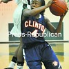 Kiyanna Edwards of Clinton drives to the hoop during the first half as Dejanye Williams defends. Edwards was fouled on the play. <br><br>(P-R Photo/Pat Hendrick)