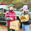 Forest Ranger Suzanne Hitt (left) of the Saratoga region delivers food to search volunteer Leisa Almekinder of Franklin Falls at a rest station near the Adirondack Loj in Lake Placid. Searchers have been looking for 22-year-old Wesley Wamsganz for nearly a week. Snow in the area is making the search more difficult.<br><br>(P-R Photo/Jack LaDuke)