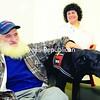 David Gardner of Malone pats Bailey, a therapy dog handled by Shoshi Satloff, while waiting at CVPH Medical Center. <br><br>(Staff Photo/Kelli Catana)