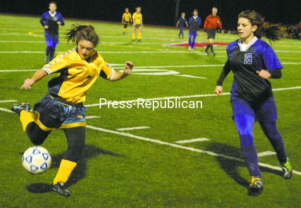 Lake Placid's Brooke Reid sends the ball upfield as Ticonderoga's Jaelyn Granger defends on the play in Section VII Class C girls' soccer semifinal Thursday in Clintonville. Bonus photos of this game will be available at midday at pressrepublican.com <br><br>(P-R Photo/Andrew Wyatt)