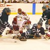 Middlebury's Charlie Strauss (18) tries to carry the puck around a cluster of Panther and Norwich players. Norwich won 3-0.<br><br>(P-R Photo/Andrew Wyatt)
