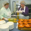 Gail and Doris LePage help prepare a meal on the first day opening of the Roman Catholic Community of St. Alexander's and St. Joseph's Soup Kitchen in Treadwell Mills Thursday afternoon. The church will be providing meals to community residents every Thursday. Doors open at the St. Joseph's Parish Hall at 5 p.m. with food service beginning at 5:30. <br><br>(P-R Photo/Andrew Wyatt)