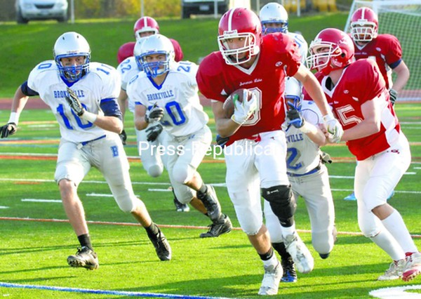 Saranac Lake's C.J. Stewart outruns a pack of Bronxville tacklers for a gain in the fourth quarter of Class C state semifinal in Kingston Saturday. Bronxville won 49-14.  <br><br>(P-R Photo/Pat Hendrick)