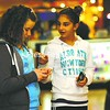 Samantha Butchinel and Samantha Snider, both 11, (left to right) text while walking through the Champlain Centre mall in Plattsburgh. Older and younger people are sometimes divided on the issue of cell-phone etiquette.<br><br>(Staff Photo/Kelli Catana)