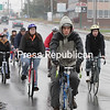 A caravan of bicyclists, who were all required to wear helmets to promote bike safety, head down Cornelia Street toward the Plattsburgh State campus Sunday afternoon after the remembrance ceremony for Yee Hao &#147;Bryan&#148; Chiel.<br><br>(P-R Photo/Gabe Dickens)