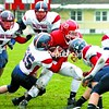 Forrest Morgan powers through a crowd of AuSable Valley tacklers on his way to a Saranac Lake touchdown in the second quarter of Saturday's Class C championship game. The Red Storm went on to win, 55-6. For the full story, see page B1.<br><br>(P-R Photo/Pat Hendrick)