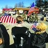 Nicholas Marvin, 7, and Julianna Marvin, 5, of Lake Placid hold American flags as a color guard passes by during a Veterans Day parade in Lake Placid. Honors were later paid to U.S. war heroes at the American Legion Post. For more on Veterans Day events around the North Country, see Page A3.<br><br>(P-R Photo/Jack LaDuke)