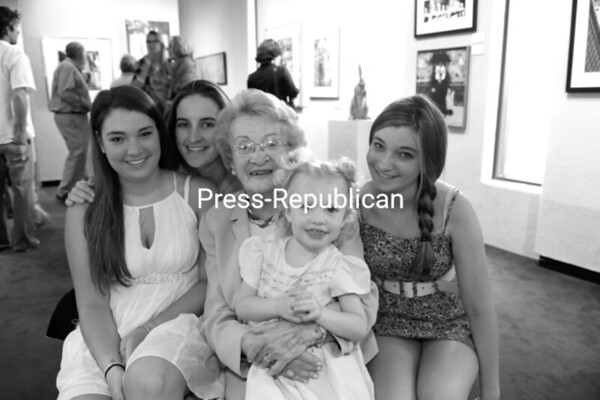 Ruthy Hart (center) is surrounded by family members at a recent tribute and art exhibit for her at the Lake Placid Center for the Arts. She was a former long-time president of the popular art center and saw it through some difficult times. With her are granddaughters Sarah Barrett, Sarah Glavin and Hanna Barrett and great-granddaughter Norah Glavin.<br><br>(P-R Photo/Jack LaDuke)